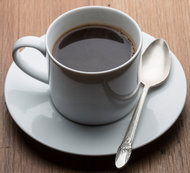 Well: Coffee May Protect Against Cancer, W.H.O. Concludes