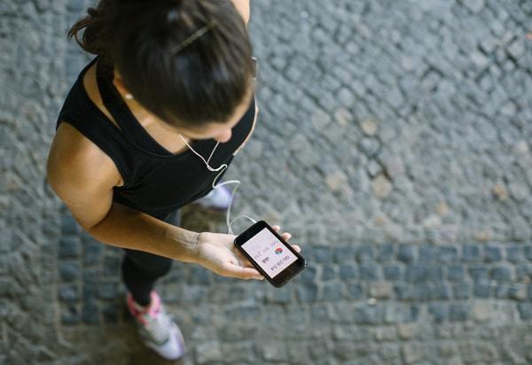 Woman Exercising and Monitoring Progress
