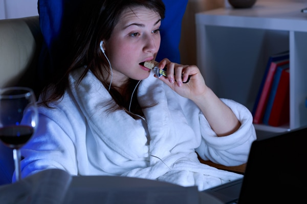 Young Woman Eating Late at Night